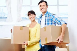 How to pack like a pro. Man and woman holding packed boxes.