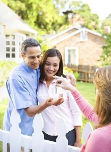 Six steps to a smooth home purchase. Young couple receiving house keys from agent.