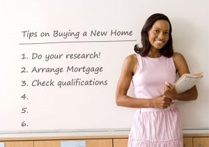 Tips on buying a new home. Woman in front of whiteboard with list of tips.